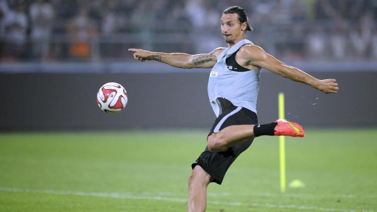 Paris Saint-Germain's Zlatan Ibrahimovic attends a training session ahead of the French Super Cup soccer match against Guingamp, in Beijing