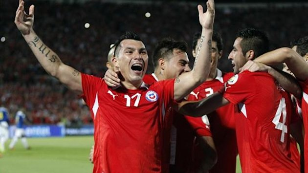 Chile's Gary Medel (17) celebrates after scoring against Ecuador during their 2014 World Cup qualifying match (Reuters)