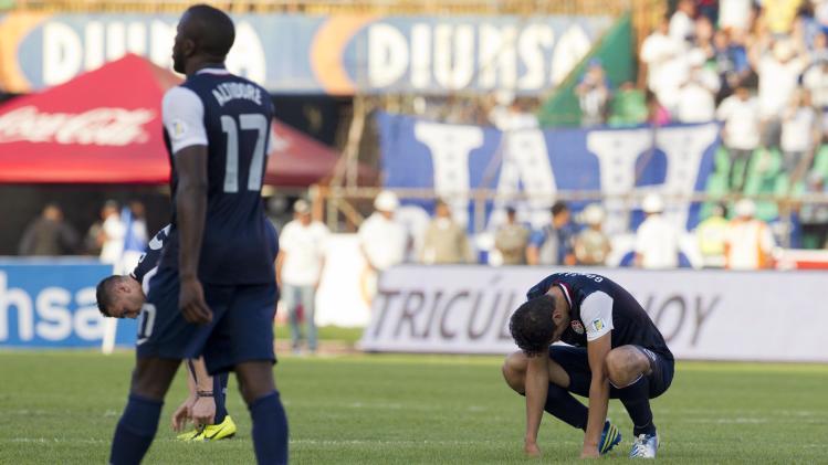 U.S. players react at the end of a 2014 World Cup qualifying soccer game against Honduras in San Pedro Sula, Honduras, Wednesday Feb. 6, 2013. Honduras won 2-1. (AP Photo/Moises Castillo)