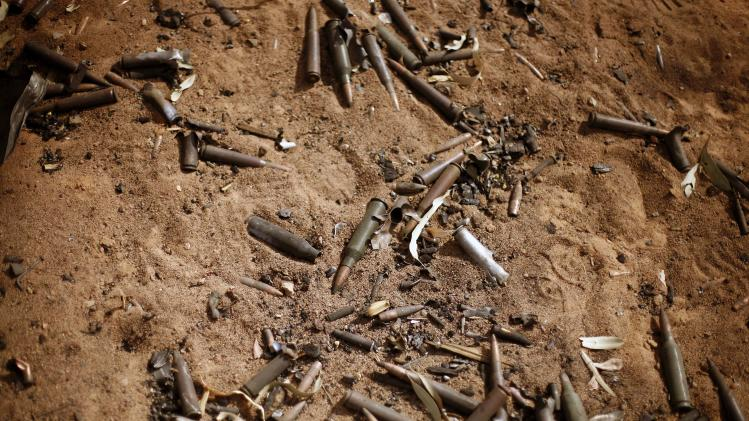 In this image taken during an official visit organized by the Malian army to the town of Konna, some 680 kilometers (430 miles) north of Mali's capital Bamako, Saturday, Jan. 26, 2013, bullets lay on the ground of a destroyed base used by islamist rebels. One wing of Mali's Ansar Dine rebel group has split off to create its own movement, saying that they want to negotiate a solution to the crisis in Mali, in a declaration that indicates at least some of the members of the al-Qaida linked group are searching for a way out of the extremist movement in the wake of French air strikes. (AP Photo/Jerome Delay)