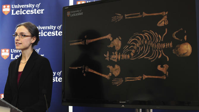 """Jo Appleby, a lecturer in Human Bioarchaeology, at University of Leicester, School of Archaeology and Ancient History, who led the exhumation of the remains found during a dig at a Leicester car park, speaks at the university Monday Feb. 4, 2013. Tests have established that a skeleton found , pictured behind, are """"beyond reasonable doubt"""" the long lost remains of England's King Richard III, missing for 500 years.(AP Photo/Rui Vieira, PA)  UNITED KINGDOM OUT - NO SALES - NO ARCHIVES"""