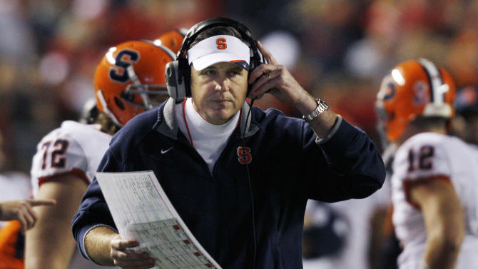 FILE - In this Nov. 13, 2010, file photo, Syracuse coach Doug Marrone stands near his players during an NCCA college football game against Rutgers in Piscataway, N.J. Marrone reached an agreement to become the Buffalo Bills' new coach Sunday, Jan. 6, 2013, three people familiar with the negotiations told The Associated Press. One person said the sides were still putting the finishing touches on the contract for Marrone to sign. (AP Photo/Mel Evans, File)