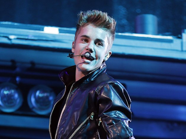 FILE - In this Sept. 30, 2012 file photo, Justin Bieber performs at the MGM Grand Garden Arena in Las Vegas. Bieber is recovering after fainting backstage at a concert in London on Thursday, March 7, 2013. A spokeswoman for Bieber said that the 19-year-old pop star was given oxygen and took a 20-minute reprieve after fainting backstage at his show at London's O2 Arena. (Photo by Isaac Brekken/Invision/AP, File)
