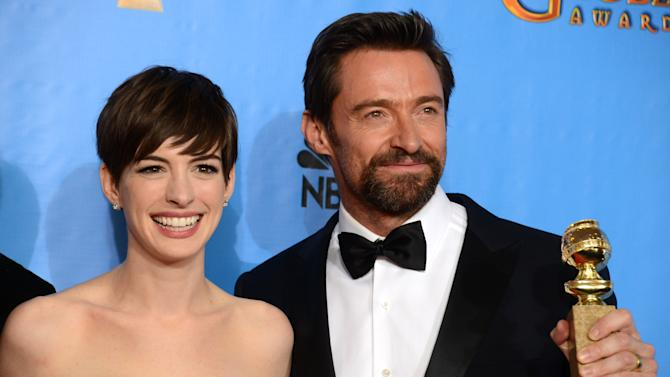 "Actors Anne Hathaway, left, and Hugh Jackman pose with the award for best motion picture comedy or musical for ""Les Miserables"" backstage at the 70th Annual Golden Globe Awards at the Beverly Hilton Hotel on Sunday Jan. 13, 2013, in Beverly Hills, Calif. (Photo by Jordan Strauss/Invision/AP)"