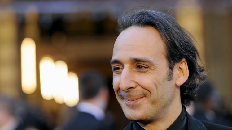 "FILE - In this Sunday, Feb. 27, 2011 file photo, composer Alexandre Desplat arrives before the 83rd Academy Awards, in the Hollywood section of Los Angeles. For the first time, a composer will lead the international jury at the Venice Film Festival. Organizers said Monday, June 23, 2014 that the jury president this year will be Frenchman Alexandre Desplat, a six-time Oscar nominee and Golden Globe winner. His many credits include the scores for ""Godzilla,"" ""The King's Speech,"" ''Argo"" and ""Philomena."" Desplat began his career in French cinema and broke into Hollywood in 2003 after composing for ""Girl with a Pearl Earring."" (AP Photo/Chris Pizzello, File)"