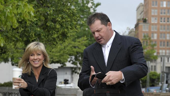 Retired Major League baseball pitcher Roger Clemens, and his wife Debra Lynn Godfrey, arrive at federal fourt in Washington, Monday, April 23, 2012. The Clemens perjury trial moves into the next phase with the planned seating of a jury and opening arguments on Monday. (AP Photo/Susan Walsh)