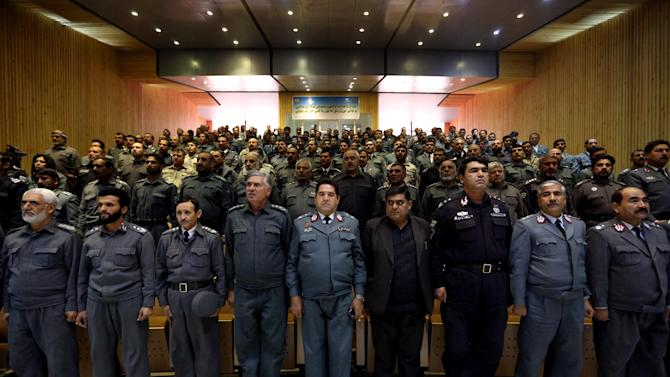 Afghan national police captains stand during their graduation ceremony at a police training center in Kabul, Afghanistan, Sunday, Dec. 21, 2014. Over 205 national police captains graduated after receiving a 2-month training program. (AP Photo/Rahmat Gul)