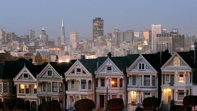 FILE-In this Monday, May 12, 2008, file photo, a row of historical Victorian homes, underscore the San Francisco skyline in a view from Alamo Square,Calif. Apartment rents in San Francisco have soared beyond the lofty levels of the original Internet boom more than a decade ago. This time, it's being driven by well-paid software engineers and Web designers who are flocking to Silicon Valley.  (AP Photo/Marcio Jose Sanchez, FIle)