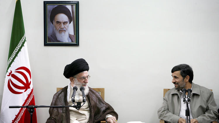 "FILE - In this Sunday, Aug. 29, 2010 file photo released by an official website of the Iranian supreme leader's office, Iranian supreme leader Ayatollah Ali Khamenei, left, and President Mahmoud Ahmadinejad, talk, during a meeting of cabinet and supreme leader, in Tehran, Iran. A portrait of the late revolutionary founder Ayatollah Khomeini hangs on the wall. In the ongoing political skirmishes among Iran's leadership, it was the equivalent of bringing out the heavy ammunition: The country's most powerful figure warning that the post of elected president could someday be scrapped. Although no overhauls appear on immediate horizon after Supreme Leader Ayatollah Ali Khamenei's comment _ he spoke only vaguely about possibilities in the ""distant future"" _ the mere mention of eliminating Iran's highest elected office shows the severity and scope of the power struggle between Khamenei and President Mahmoud Ahmadinejad. (AP Photo/Office of the Supreme Leader, File) ** EDITORIAL USE ONLY, NO SALES **"