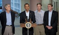 US President Barack Obama speaks alongside Colorado's governor and US senators at the University of Colorado Hospital in Aurora, Colorado, on July 22. His hair dyed orange, eyes staring out blankly or drooping shut, presumed Colorado gunman James Holmes seemed unhinged Monday as he made a bizarre first appearance in court