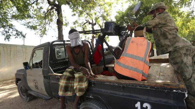 A blind-folded suspect is detained by Somalia security forces after attackers from the militant group al Shabaab invaded the African Union base in Somalia's capital Mogadishu