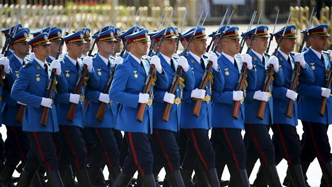 Serbian soldiers march during the military parade marking the 70th anniversary of the end of World War Two, in Beijing