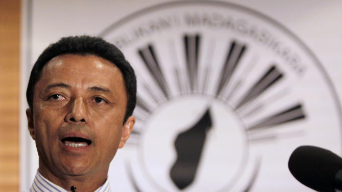 Exiled president of Madagascar, Marc Ravalomanana, speaks during a news conference in Johannesburg, Friday, Jan. 20, 2012. Ravalomanana, exiled in South Africa since a 2009 coup, said Friday he will return to his Indian Ocean homeland on Saturday even though he faces arrest there. (AP Photo/Denis Farrell)