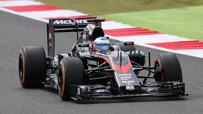 CAR: McLaren's Fernando Alonso in action during morning practice