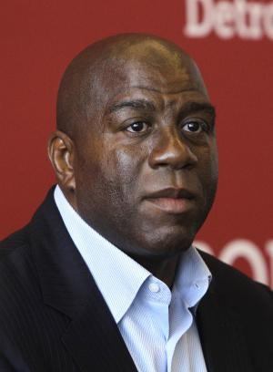 "FILE - In this July 21, 2011, file photo, Hall of Fame basketball player turned businessman Earvin ""Magic"" Johnson appears during a news conference in Detroit. Los Angeles Dodgers owner Frank McCourt has announced an agreement Tuesday night, March 27, 2012, to sell the bankrupt team for $2 billion to a group that includes Johnson and former Atlanta Braves and Washington Nationals President Stan Kasten. (AP Photo/Carlos Osorio, File)"