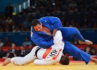Hungary's Barna Bor (white) competes with Brazil's Rafael Silva (blue) during their men's +100kg judo contest repechage match of the London 2012 Olympic Games on August 3, 2012 at the ExCel arena in London. AFP PHOTO / MIGUEL MEDINA