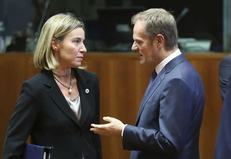 EU foreign policy chief Mogherini listens to EU Council President Tusk during a EU leaders summit in Brussels