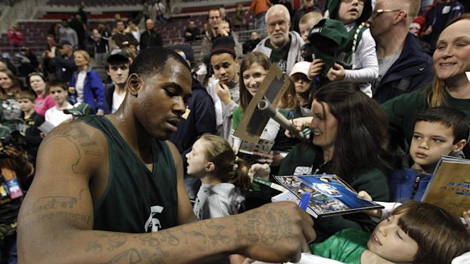 Michigan State forward Derrick Nix signs autographs for fans after practice for a second-round game of the NCAA college basketball tournament at The Palace in Auburn Hills, Wednesday, March 20, 2013.  Michigan State plays Valparaiso on Thursday. (AP Photo/Paul Sancya)