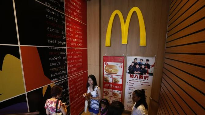 Diners leave a McDonald's restaurant in Hong Kong
