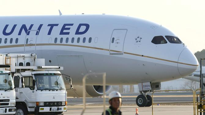 A United Airlines Boeing 787 is parked at Narita Airport in Narita, east of Tokyo, Thursday, Jan. 17, 2013. The Federal Aviation Administration late Wednesday grounded Boeing's newest and most technologically advanced jetliner until the risk of battery fires is resolved. The order applies only to the six Dreamliners operated by United Airlines, the lone U.S. carrier with 787s. (AP Photo/Kyodo News)  JAPAN OUT, MANDATORY CREDIT, NO LICENSING IN CHINA, HONG KONG, JAPAN, SOUTH KOREA AND FRANCE