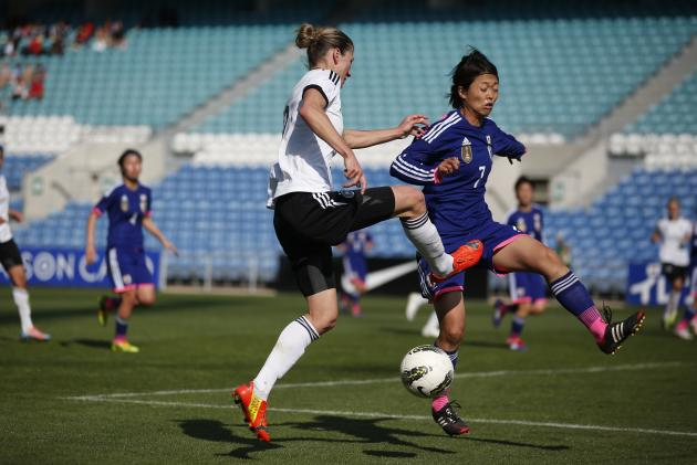 Germany's Schmidt fights for the ball with Japan's Ando during the Algarve Women's Soccer Cup final match at Algarve stadium in Faro