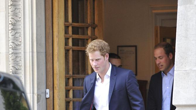 Britain's Prince William and Prince Harry leave the London Clinic in central London after visiting their grandfather, Prince Phillip, who is recovering in hospital after exploratory abdominal surgery, London, Friday June 14, 2013 (AP Photo/PA Nick Ansell) UNITED KINGDOM OUT