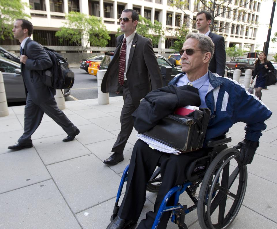 Daniel Butler, the prosecutor for the perjury trial oof former Major League Baseball pitcher Roger Clemens, front, leaves Federal Court in Washington, Tuesday, April 17, 2012.   (AP Photo/Manuel Balce Ceneta)