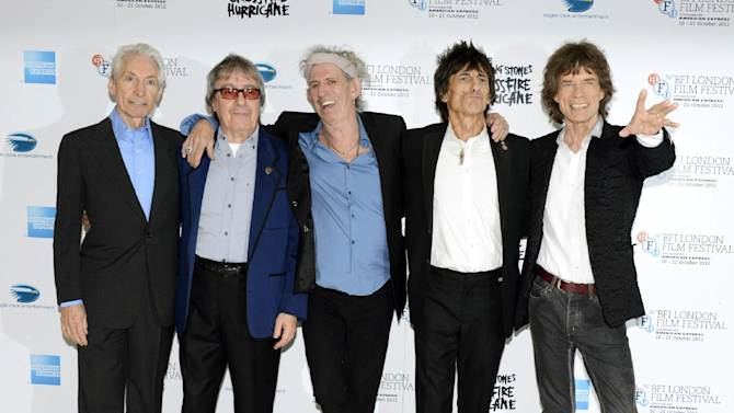 """This Oct. 18, 2012 file photo shows, from left, Charlie Watts, Bill Wyman, Keith Richards, Ronnie Wood and Mick Jagger of The Rolling Stones at London Film Festival American Express Gala for their film, """"The Rolling Stones - Crossfire Hurricane"""" at Odeon West End  in London. The archetypal rock 'n' roll band is set for five concerts in London and the New York area over the next month, released another hits compilation with two new songs on Tuesday, Nov. 13, and will see HBO premiere a documentary on their formative years, """"Crossfire Hurricane,"""" on Thursday Nov. 15. Wyman was a member of the band until 1993.  (Photo by Jon Furniss/Invision/AP, file)"""