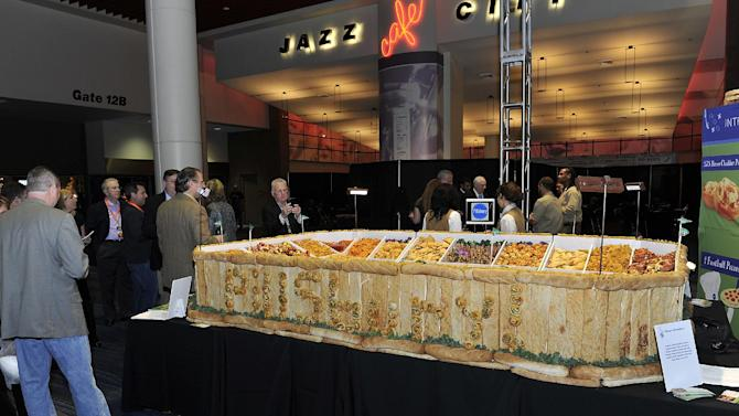 """Pillsbury unveiled its Ultimate Snackadium at the Taste of the NFL's """"Party with a Purpose"""" to support the fight against hunger on Saturday, Feb. 2, 2013 in New Orleans. (G. Newman Lowrance/AP Images for Pillsbury)"""