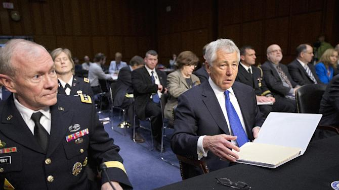 Defense Secretary Chuck Hagel, right, and Joint Chiefs Chairman Gen. Martin Dempsey testify on Capitol Hill in Washington, Wednesday, April 17, 2013, before the Senate Armed Services Committee hearing on the Pentagon's budget for fiscal 2014 and beyond.  (AP Photo/J. Scott Applewhite)