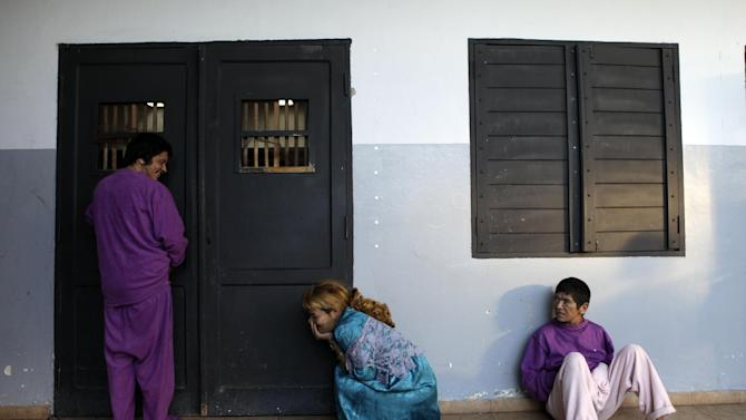 """In this May 29, 2013 photo, patients wait for breakfast inside a bedroom at the Neuro-Psychiatric Hospital in Asuncion, Paraguay. Hospital Director Teofilo Villalba said its patients come from Paraguay's lower and middle classes and """"they can't be kept without nutritious food because they would go into a crisis. No one can recover while hungry. When the rich get sick here, they're treated at private hospitals or are sent abroad."""" (AP Photo/Jorge Saenz)"""