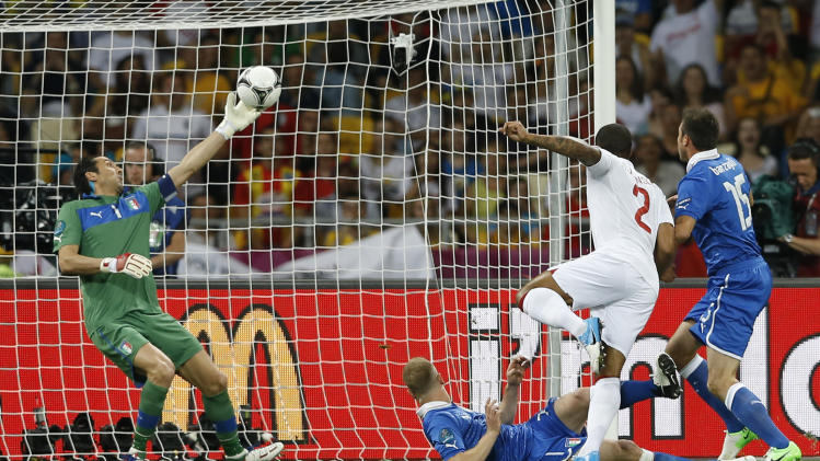 Italy goalkeeper Gianluigi Buffon saves a shot from England's Glen Johnson during the Euro 2012 soccer championship quarterfinal match between England and Italy in Kiev, Ukraine, Sunday, June 24, 2012. (AP Photo/Kirsty Wigglesworth)