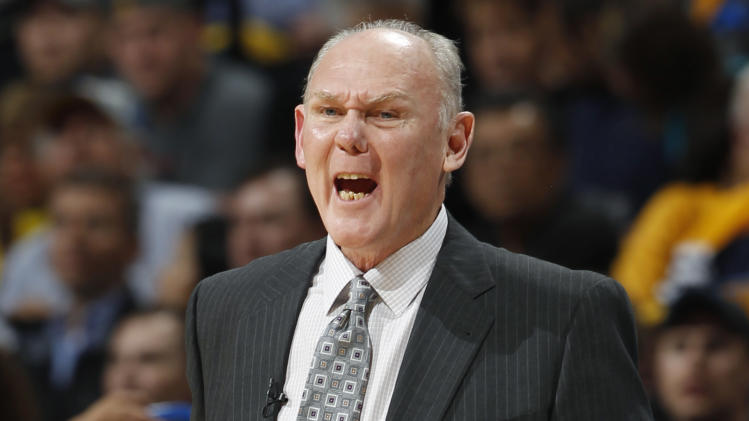 Denver Nuggets head coach George Karl directs his team against the Golden State Warriors during the first quarter of Game 5 of their first-round NBA basketball playoff series, Tuesday, April 30, 2013, in Denver. (AP Photo/David Zalubowski)