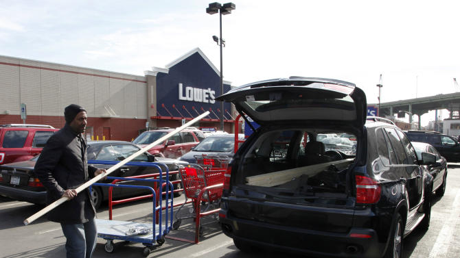 In this Feb. 21, 2012 photo, a customer shops at Lowe's, in New York. Lowe's Cos. said Monday, Feb. 27, 2012, its fourth-quarter net income rose 13 percent on an 11 percent rises in revenue as it benefited from an extra week in the period. (AP Photo/Mark Lennihan)
