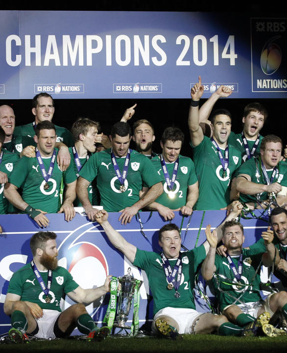 Ireland's rugby team players celebrate after defeating France and winning the Six Nations Rugby Union tournament at the stade de France stadium, in Saint Denis, outside Paris, Saturday, March 15,