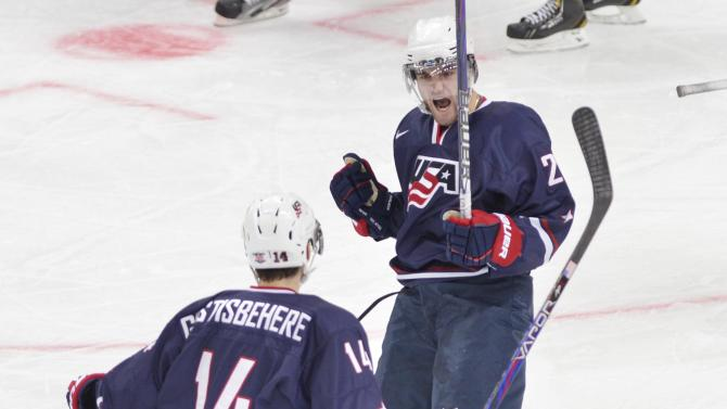 Team USA's Rocco Grimaldi, right, celebrates his first goal against Sweden with teammate Shayne Gostisbehere during second period gold medal hockey action at the IIHF World Junior Championships in Ufa, Russia, on Saturday, Jan. 5, 2013. (AP Photo/The Canadian Press, Nathan Denette)