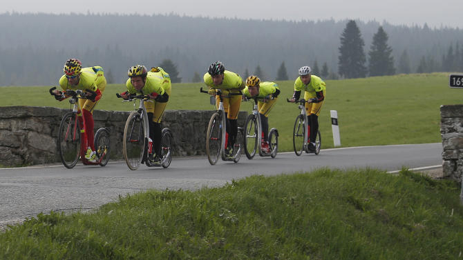 A group of kick bikers train in the Sumava Mountains, Southwest Czech Republic, Monday, May 6, 2013.  An international team of six riders from the Czech Republic, Finland and the Netherlands is set to do what no one has done before: to mark the 100th edition of the Tour de France, they plan to cover the entire distance on kick bikes. (AP Photo/Petr David Josek)