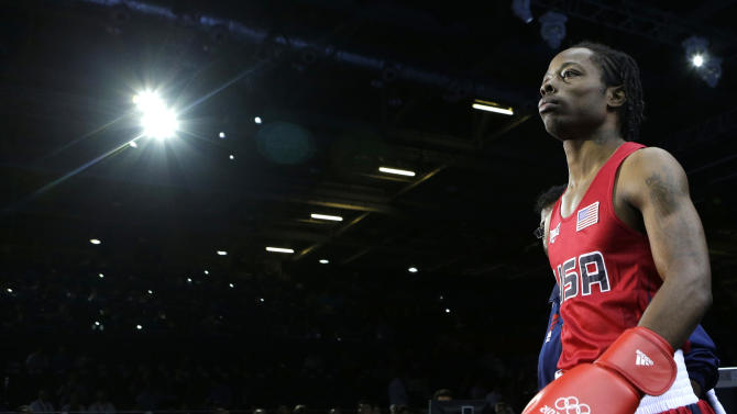 United States' Warren Raushee makes his way to the ring to fight France's Nordine Oubaali in a men's flyweight 52-kg preliminary boxing match at the 2012 Summer Olympics, Friday, Aug. 3, 2012, in London. (AP Photo/Patrick Semansky)