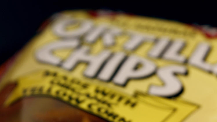 In this March 15, 2012 photo, a genetically engineered label is seen on a package of tortilla chips in Montpelier, Vt. Eighteen states are considering legislation that would require labeling of genetically modified foods, even though no study says genetically modified food is unhealthy or unsafe. (AP Photo/Toby Talbot)
