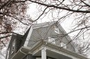 A real estate sign hangs in front of a home, in Milton, Mass., Wednesday, Nov. 16, 2011. The average rate on the 30-year mortgage stayed near 4 percent for the third straight week, just above the record low. But cheap mortgage rates have done little to boost home sales or refinancing. (AP Photo/Steven Senne)