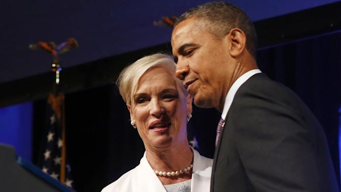 President Barack Obama is introduced by Cecilia Boone, chair of the board of Planned Parenthood, before speaking at the 2013 Planned Parenthood National Conference in Washington, Friday, April 26, 2013. (AP Photo/Charles Dharapak)