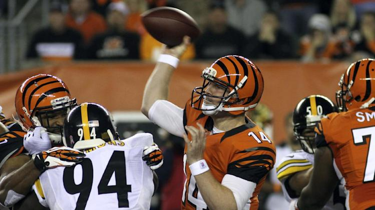 Cincinnati Bengals quarterback Andy Dalton (14) passes against the Pittsburgh Steelers in the first half of an NFL football game, Sunday, Oct. 21, 2012, in Cincinnati. (AP Photo/Tom Uhlman)