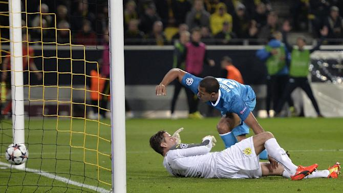 Zenit's Jose Salomon Rondon, top, scores his side's 2nd goal during the UEFA Champions League last 16 second leg soccer match between Borussia Dortmund and FC Zenit in Dortmund, Germany, Wednesday, March 19, 2014. On the ground is Dortmund goalkeeper Roman Weidenfeller