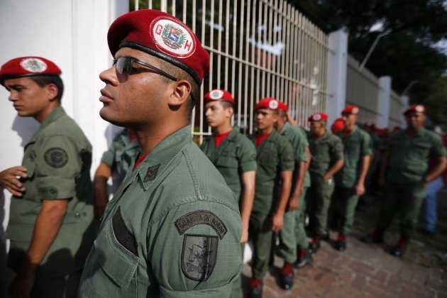 Venezuelan presidential honor guards line up before casting their vote during the presidential elections in Caracas