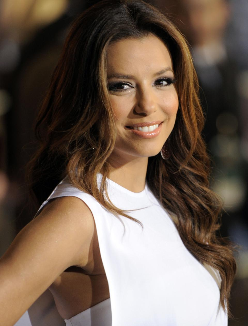 "FILE - In this May 7, 2011 file photo, actress Eva Longoria arrives at the World Premiere of ""Pirates of the Caribbean: On Stranger Tides"" at Disneyland in Anaheim, Calif. Longoria is an executive producer of the documentary ""The Harvest.""  (AP Photo/Chris Pizzello, file)"