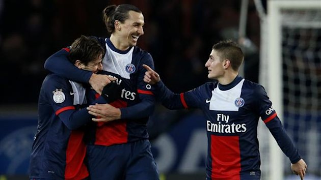 Paris St Germain's Zlatan Ibrahimovic (C) celebrates between Maxwell (L) and Marco Verratti after he scored against FC Sochaux during their French Ligue 1 soccer match at the Parc des Princes Stadium in Paris December 7, 2013 (Reuters)