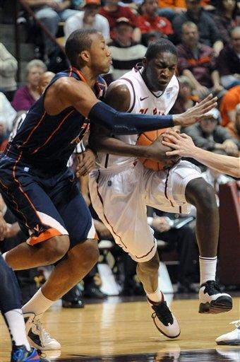 Scott leads No. 25 Virginia past Va. Tech 61-59
