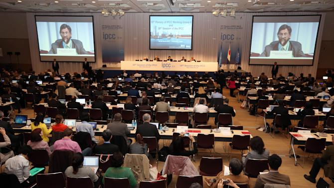 The chair of the Intergovernmental Panel on Climate Change (IPCC) Rajendra K. Pachauri, second from right, delivers an opening remarks during the opening session of the 10th Plenary of (IPCC) Working Group II and the 38th Session of the IPCC in Yokohama, near Tokyo Tuesday, March 25, 2014. The hundreds of scientists from 100 countries meeting in this Japanese port city are putting finishing touches on a massive report emphasizing the gravity of the threat the changing climate poses for communities from the polar regions to the tropics. (AP Photo/Eugene Hoshiko)