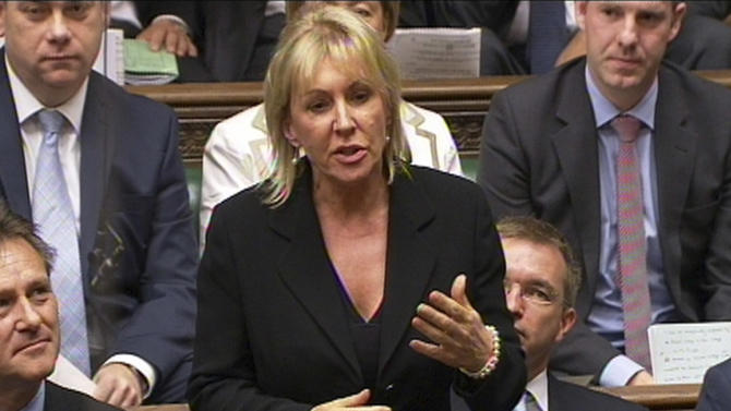 "FILE - In this photo made from video on Sept. 5, 2012,  Conservative MP Nadine Dorries talks during Parliament, in London. A British lawmaker is swapping the political jungle for the Australian rainforest and becoming a contestant on a reality TV show. A British lawmaker is swapping the political jungle for the Australian rainforest and becoming a contestant on a reality TV show. Dorries was slammed Tuesday, Nov. 6, 2012, for taking up to a month off from her parliamentary duties. Former Conservative legislator Harry Greenway called the decision ""outrageous."" (AP Photo/PA)  UNITED KINGDOM OUT  NO SALES  NO ARCHIVE As well as risking the anger of those she represents for taking extended leave from her day job, she will also face questions from senior MPs, The Sun said. See PA story SHOWBIZ Dorries. Photo credit should read: PA Wire"
