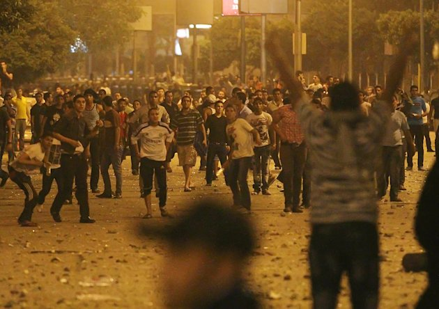 Egyptians clash early Sunday, April 29, 2012 in Cairo, Egypt. Security officials say a protester has been killed when clashes erupted between unidentified assailants and demonstrators gathered outside the Defense Ministry in the Egyptian capital to call for an end to military rule. (AP Photo/Ahmed Ali)